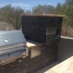 "42"" Alfresco, double side burner, pizza oven, three stack drawer, paper towel holder, trash drawer, under counter sink."